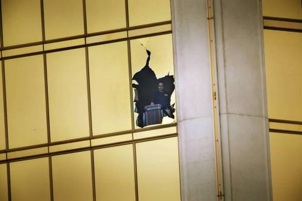 FBI agents survey window of crime scene of Las Vegas mass shooting.jpg