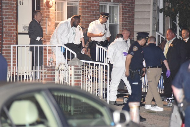 ME removes one of the four bodies of the victims after the Shield's murder suicide in Queens, NY July 30.jpg
