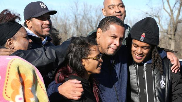 Nevest Coleman hugs his daughter, Chanequa Allen, and son Nicholas Coleman outside the prison on Nov. 20, 2017