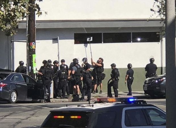 Police try to view situation inside Trader Joe's during hostage situation.JPG