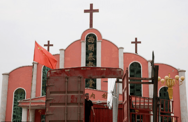 Chinese flag flies over a church near the city of Pingdingshan in Henan province 1.png