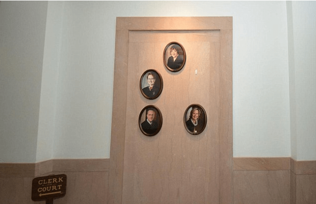 Hallway of the West Virginia Supreme Court with framed official portraits of the justices.png
