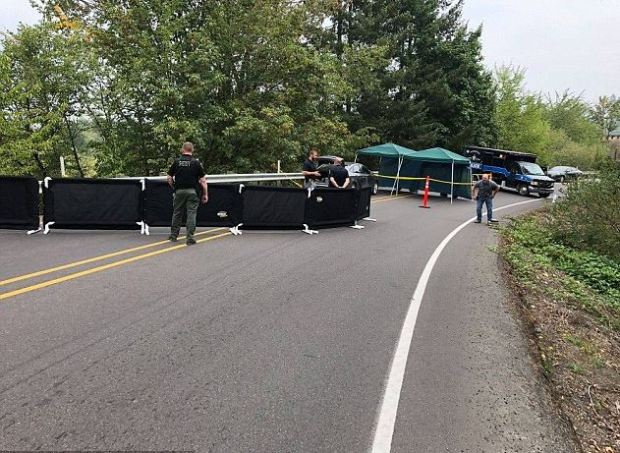 Police seal off the point where Meighan Cordie exited her mother's moving car, hitting her head on a guard rail before sliding down an embankment 1.JPG