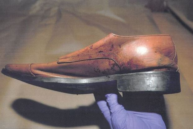Blood spattered shoe presented as evidence was found in the garbage near James Rackover's home in Manhattan, NY 4