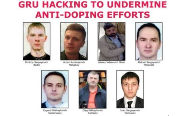 FBI released this wanted poster, of seven Russian men accused of launching cyber-attacks 1.JPG