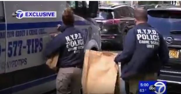 Police remove evidence from Anya Johnson's 15 th floor apt.JPG