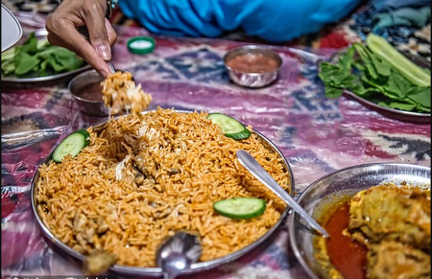 A Moroccan woman has been accused of butchering her lover, cooking his remains and serving them to workers as machboos, a traditional rice dish.png