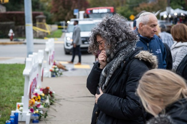 Mourners seen at a memorial outside the Tree of Life synagogue in Pittsburgh on Monday, two days after a gunman killed 11 congregants.jpg