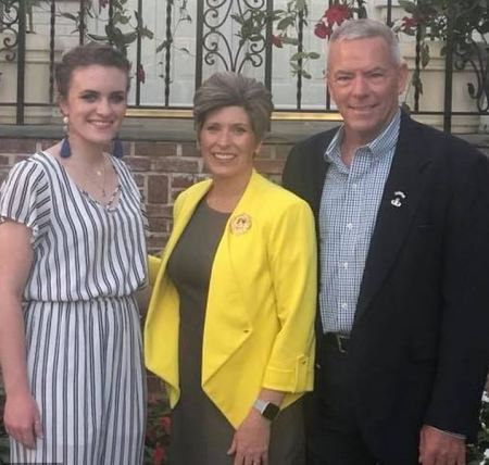 Senator Joni Ernst [center], her daughter Libby Ernst, [left] and her husband Gail Ernst [left] 1