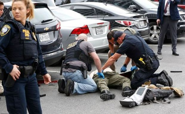 Brian Issack Clyde on the ground after he was shot 3