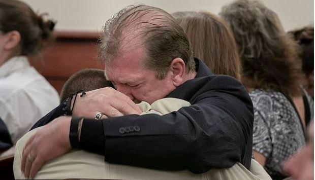 Tim Jones, Sr., embraces his son, Travis Jones Jr during the sentencing phase