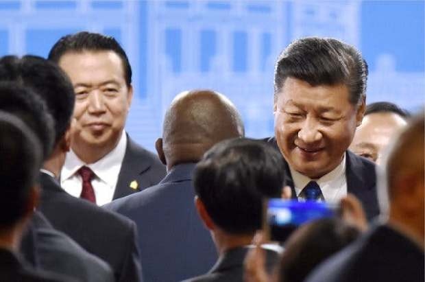 meng Hongwei [left] with president Xi Jinping [right] 1