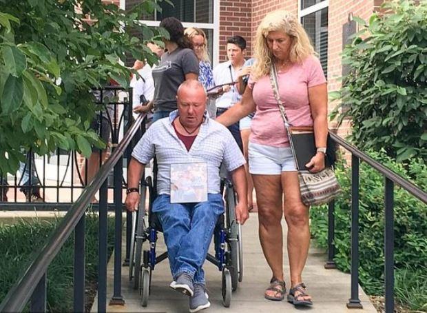 Cecil Spurlock, [in wheelchair], and his fiancée, Cheryl Lynn Wright.JPG