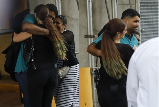 Juan Rodriguez embraces his wife after he is released from custody 1