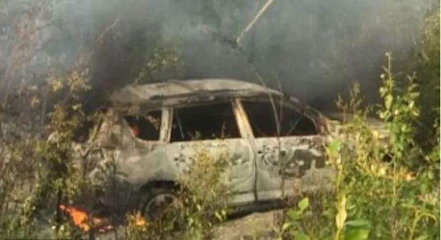 Kam Mcleod, 1and Bryer Schmegelsky's  RAV4 after it was set on fire in rural Manitoba on Monday hours after their photographs were released by the police 1.JPG