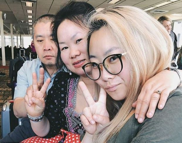 Laile Vang (right) with her parents Teng and Mai Chang Vang (left) 1