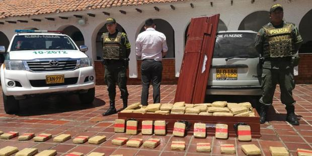 Colombian police discover cannabis haul hidden in a coffin 8