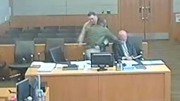 Defendant LamontPayne got up to leave the courtroom, then sucked-punched his attorney Vladimir Gagic 1.jpg