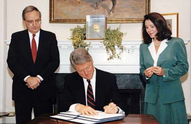 George Mitchell, [left], with Bill Clinton [center], and Nancy Pelosi [right] 1