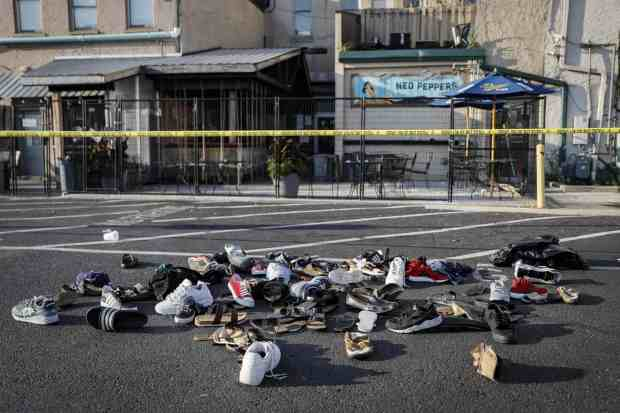 Pairs of shoes belonging to victims piled behind the Ned Peppers bar..jpg