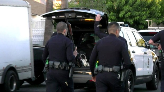 Police found a 2-year-old girl in a playpen Aug. 19, 2019, at the scene of an apparent murder-suicide in LA 1
