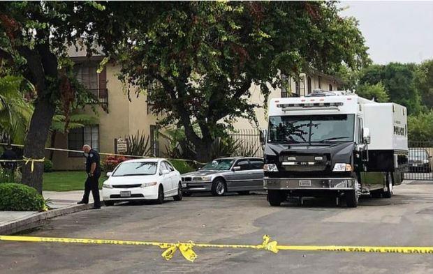 Police work at the scene of a stabbing on Thursday.JPG