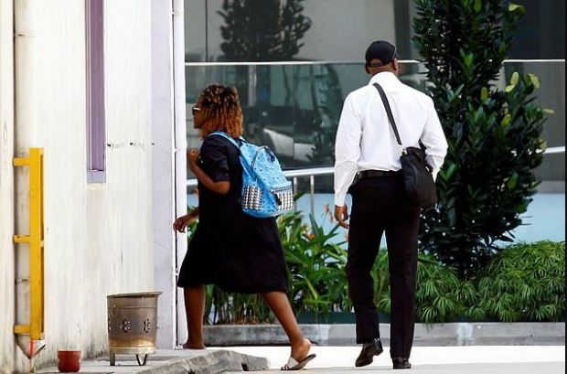 Bona Mugabe, the daughter of Robert Mugabe, is seen outside the funeral parlour in Sigapore 1