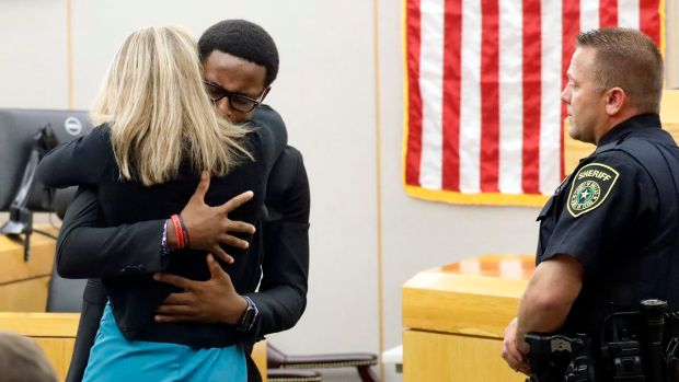 Botham Jean's younger brother, Brandt, shared a lengthy courtroom embrace with his brother's killer after the sentencing.jpg