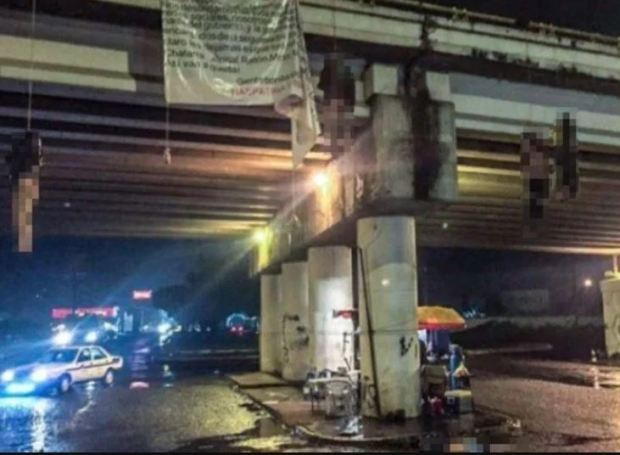 Butchered bodies hung under a bridge allegedly by Jalisco cartel the CJNG