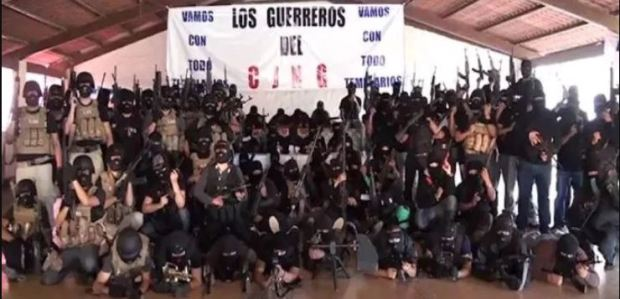 Foot soldiers of the CJNG cartel pose with military grade weapons 6.JPG