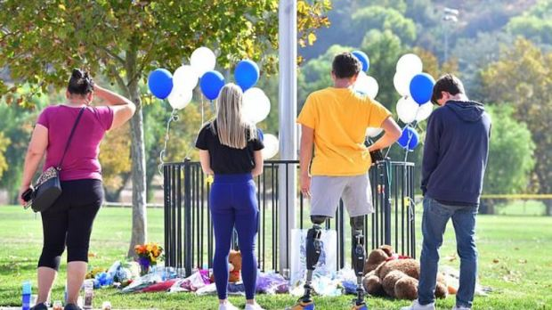 Students and members of the community at the tribute left for the shooting victims on Friday  after the shooting at Saugus High School in Santa Clarita, California on Nov 14,  1.JPG