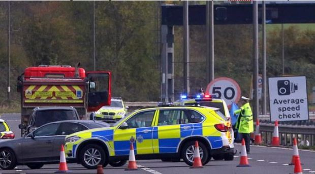 UK police secure the spot where Ron Carey crashed his vintage car 1.JPG