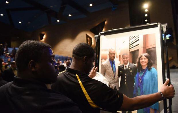 Relatives put up portrait of Richard Collins III.JPG