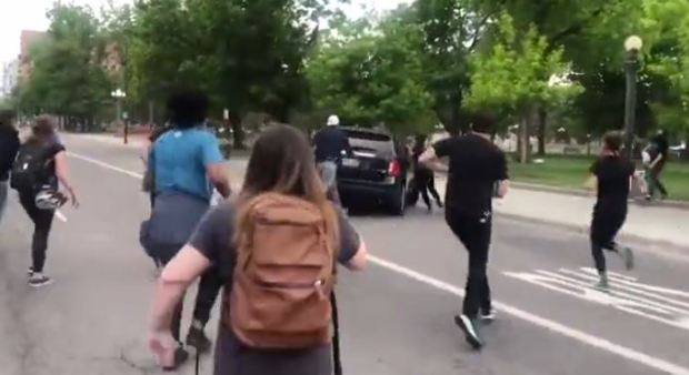SUV driver targets and runs over Justice 4 George Floyd protester 5