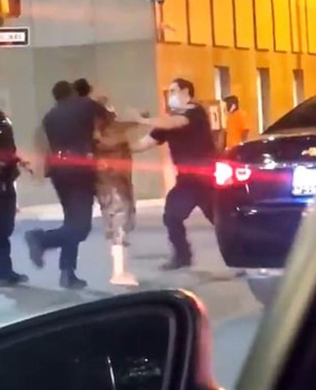 Cop knocks woman out in Baltimore 2