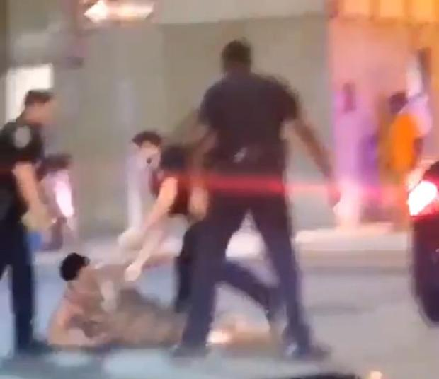 Cop knocks woman out in Baltimore 4