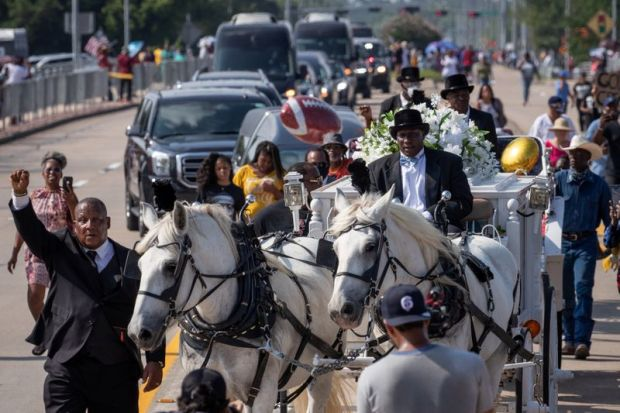 Horse drawn carriage with coffin of George Floyd enters cemetery ahead of burial in Pearland, Texas