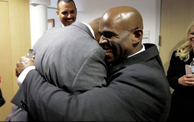 Malcolm Scott [right] hugsDe'marchoe Carpenter [left] 2
