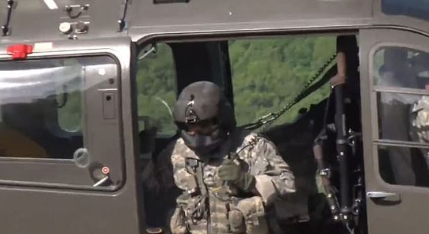 Search crews in a National Guard helicopter scour the area where Julie Wheeler supposedly 'disappeared'