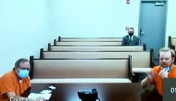 Gregory McMichael [left] and his son Travis McMichael in court 1