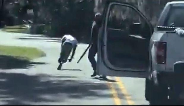 Travis McMichael [right] shoots Ahmaud Arbery [left] 2