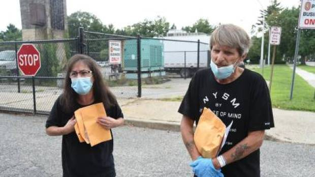 John McEneaney, [left], and girlfriend Mindy Canarick, [right] 4