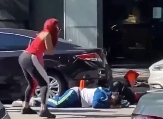 Woman looks on in horror at shooting of Carlton D Weekly, aka FBG Duck 1