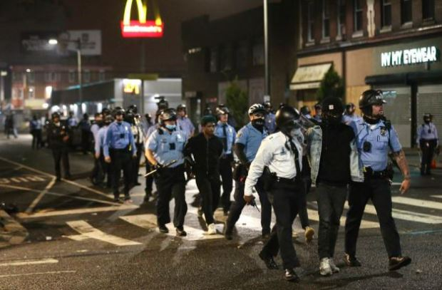 This image has an empty alt attribute; its file name is Protesters-arrested-in-Phladelphia-Oct-26-after-police-shot-and-killed-Walter-Wallace-1.jpg