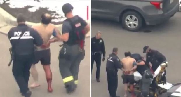 This image has an empty alt attribute; its file name is Shirtless-Colorado-shooter-with-blood-running-down-his-leg-being-escorted-by-police-4.jpg