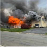 Maryland woman, 47, faces murderand arson chares after intentionally sets house on fire and calmly walks away - Gail Metwally watched the fire burn reading a book in a chair on the front lawn, as people trapped inside screamed for help