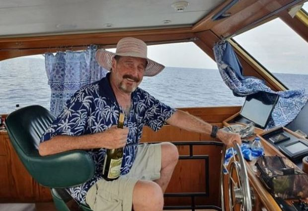 This image has an empty alt attribute; its file name is John-McAfee-sailing-1.jpg