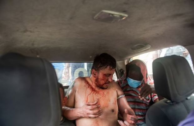 This image has an empty alt attribute; its file name is Bloodied-mercenary-arrested-in-Haiti-2.jpg
