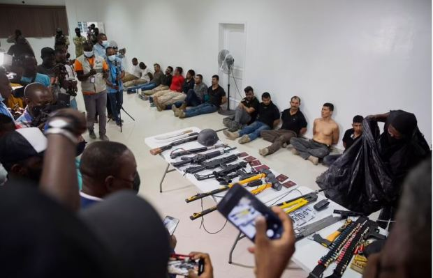 This image has an empty alt attribute; its file name is Weaponry-mobile-phones-passports-and-other-items-are-being-shown-to-the-media-along-with-suspects-in-the-assassination-of-president-Jovenel-Moise-3.jpg