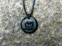 """Maya Nawal Glyph """" Imox """" necklace $20.00 Amount Available: 1 The glyph signifies a glass of water. The top part is the mouth; the vertical lines represent the roundness. It also represents the maternal breasts, ready to provide milk to the child. It also represents a hand stretched downward. This day is good to increase internal powers. It is a good day to fortify the spirit. It is a good day to ask for rain; for the purification of the rivers, lakes and oceans."""